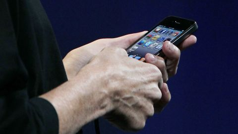 """Jobs was back to unveil the <strong>iPhone 4</strong> on June 7, 2010, at Apple's developers conference. The phone boasted a high-res """"retina display"""" and a new, more angular design, but it suffered from an antenna flaw that caused weak signals and dropped calls for many consumers. In a rare move, Apple later offered free """"bumpers"""" to address the antenna issue."""