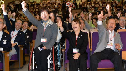 Tokyo joined the ranks of multiple host cities, having staged the sporting showpiece in 1964. Here former Olympic athletes Hiromi Miyake (C) and Yoshiyuki Miyake (R) cheer the announcement back in Japan.