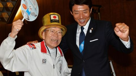"""Octogenarian """"Olympic superfan"""" Naotoshi Yamada (L) and former Japanese tennis player Shuzo Matsuoka (R) were among those to cheer the announcement in the early hours in Tokyo."""