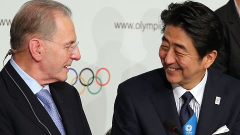 Abe is congratulated by IOC president Jacques Rogge (left) who was standing down after 12 years in the role. The 71-year-old was succeeded by Thomas Bach.