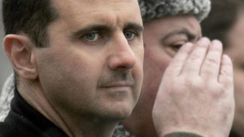 MOSCOW, RUSSIAN FEDERATION: Syrian President Bashar al-Assad inspects a guard of honor during a wreath laying ceremony at the tomb of the unknown soldier in Moscow, 25 January 2005.