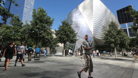 A visitor to the National September 11 Memorial & Museum takes in the sight.