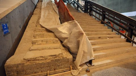 The original stairway from the World Trade Center Plaza to Vesey Street, left, is seen at the museum.