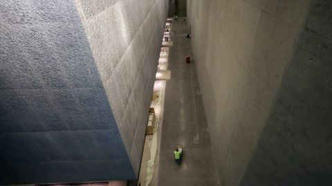 Contractors work to finish construction of the memorial and museum.