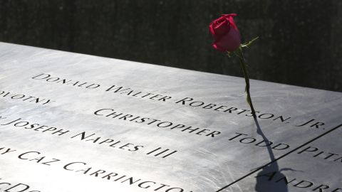 A rose is placed next to the name of a victim of the terrorist attacks on the World Trade Center at the North Pool of the memorial.