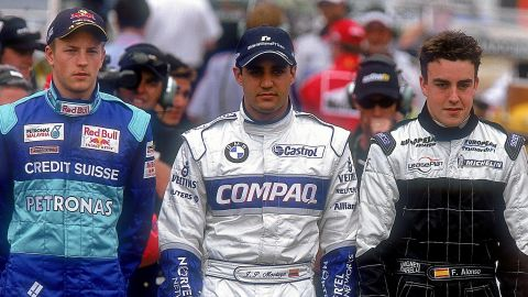 Raikkonen (left) was one of many talented drivers making their F1 debut in 2001, along with future McLaren teammate Juan Pablo Montoya and Fernando Alonso (right) -- who he would partner at Ferrari in 2014.
