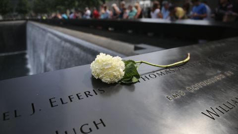 A flower lies atop names of victims at the 9/11 Memorial in New York on September 10.
