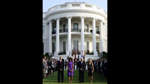 President Barack Obama, first lady Michelle Obama, Vice President Joe Biden and his wife, Jill Biden, observe a moment of silence on the South Lawn of the White House on September 11.