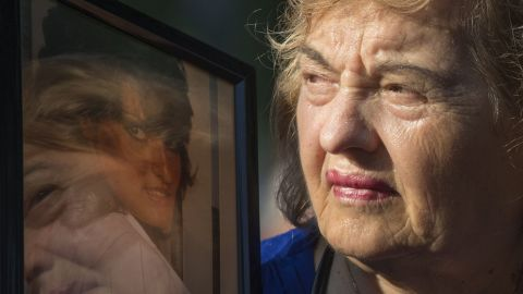 Ester DiNardo, mother of Marisa DiNardo, clutches a photograph of her daughter at the 9/11 Memorial ceremonies in New York.