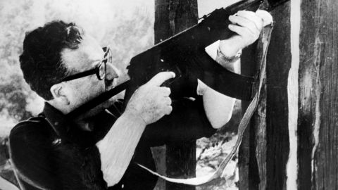 (FILE) Picture taken circa 1971 in Santiago, showing Chilean President Salvador Allende testing a Kalashnikov machine gun given to him as a gift by then-Cuban President Fidel Castro. Experts studying the remains of Salvador Allende concluded the former president committed suicide as soldiers involved in a 1973 coup closed in on the presidential palace, the late leader's daughter said on July 19, 2011 in Santiago.
