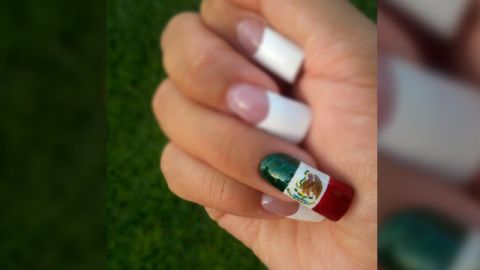 """This hands-on display of national pride was captured by Silvia Gutierrez from California. """"I was brought up in a Mexican American family and since childhood we were taught to embrace our heritage. Mexican Independence Day means so much to my family; we celebrate it with parades, lots of good food and loud Mariachi music,"""" said the cosmetologist who painted her nails herself."""
