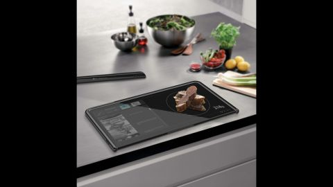 """<a href=""""http://www.yankodesign.com/2012/04/17/digital-cutting-board/"""" target=""""_blank"""" target=""""_blank"""">This digital cutting board</a> is designed to be a touchscreen device, a food scale and a cutting board all in one."""