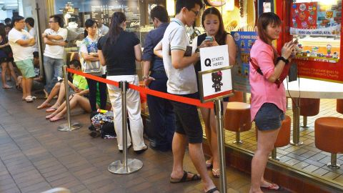 People wait in line to purchase a Hello Kitty toy in a skeleton outfit at a McDonald's restaurant in Singapore. Tempers flared and police had to be called in on June 27 as anxious Singaporeans rushed to McDonald's outlets to buy Hello Kitty plush toys being sold by the chain as a promotion.