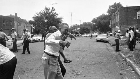 """A grieving relative is led away from the site of the <a href=""""http://www.cnn.com/2013/06/13/us/1963-birmingham-church-bombing-fast-facts/index.html"""">16th Street Baptist Church bombing</a> in Birmingham, Alabama, on September 15, 1963. Four black girls were killed and at least 14 others were injured, sparking riots and a national outcry."""