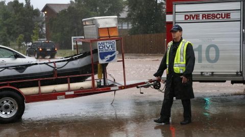 A dive rescue team moves toward floodwaters in Boulder on September 12.