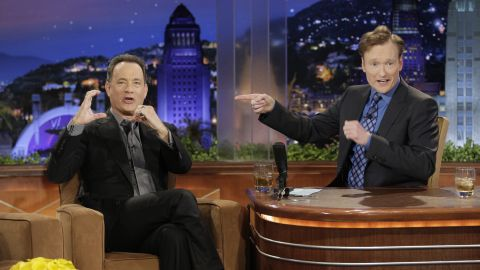 """One of Conan's early """"Tonight Show"""" guests, Tom Hanks, """"ruined"""" Conan's life. <a href=""""http://gawker.com/5686066/conan-obrien-to-tom-hanks-you-ruined-my-life"""" target=""""_blank"""" target=""""_blank"""">As he later explained on TBS' """"Conan,""""</a> Hanks repeated it on """"Tonight Show"""" and popularized the nickname """"Coco."""""""