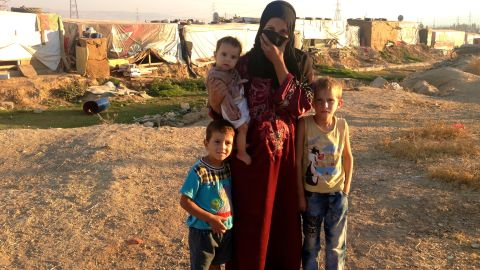 Abdel, right, his mother and two younger brothers share a 10-by-10 tent at the camp.