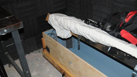A child-sized coffin is found in the locked basement. Authorities found tens of thousands of computer images and videos of child pornography in his home in Worcester, Massachusetts.