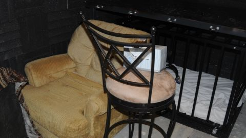 The bed and cage in the dungeon. The cage has a built in feeding hole.