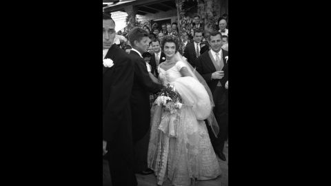 Jackie's wedding dress contained 50 yards of material.