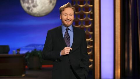 """After a wildly popular nationwide comedy tour in 2010, Conan debuted his new late night show on TBS to much fanfare. <a href=""""http://vimeo.com/24128620"""" target=""""_blank"""" target=""""_blank"""">The cold open</a> joked about Conan's NBC afterlife, which supposedly included doing a bunch of low-paying jobs and being a lazy bum around the house. (He even tried to get work at """"Mad Men's"""" advertising world, where Jon Hamm as Don Draper reminded him that he has zero ad experience, and also, it's set in 1965 and Conan would be 2 years old.)"""