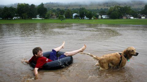 Nicky Toor, 15, floats on the flooded lawn of North Boulder Park in Boulder on September 12.