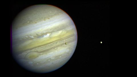 Jupiter, its Great Red Spot and three of its four largest satellites are visible in this photo taken February 5, 1979, by Voyager 1.