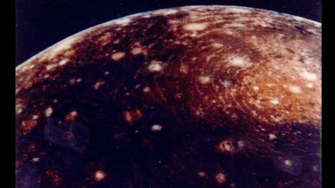 """This image of Jupiter's moon Callisto was captured from a distance of 350,000 kilometers. The large """"bull's-eye"""" at the top of the image is believed to be an impact basin formed early in Callisto's history. The bright center of the basin is about 600 kilometers across and the outer ring is about 2,600 kilometers across."""