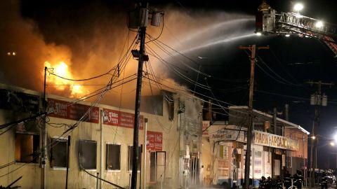 Firefighters battle a blaze in a building on the boardwalk in Seaside Park, New Jersey, on September 12.