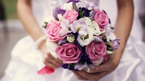 """One bride says she worked out a deal with her florist to """"rent"""" the flowers, which were collected at the end of the night and brought in to decorate local hotels and restaurants."""