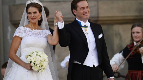 The newly wed Princess Madeleine of Sweden and Christopher O'Neill hold hands outside the chapel on Saturday, June 8, 2013 at the royal palace in Stockholm after the Swedish Royal wedding ceremony.