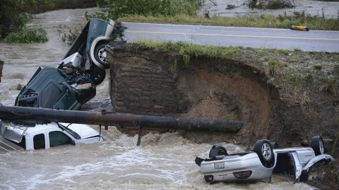 Three vehicles crashed into a creek after the road washed out from beneath them in Broomfield, Colorado, on September 12. Three people were rescued.