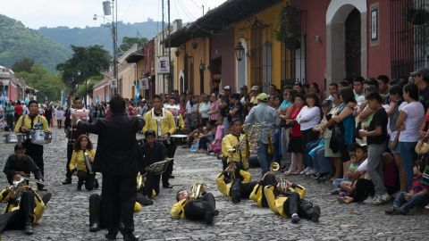 """In the Independence Day parade in Antigua, Guatemala there are a lot of <a href=""""http://ireport.cnn.com/docs/DOC-1024299"""" target=""""_blank"""">marching bands</a>. """"They take the choreography as seriously as the music. This particular band was unique. Lying down isn't common and was just part of this band's performance. I just happened to arrive at the spot when they were doing that part of their routine,"""" said Alana McConnon, from Australia who is currently living in Guatemala. """"The music is generally marching music, though often modern pop tunes are performed as well, all with a heavy focus on the percussion,"""" she added."""
