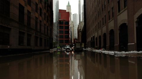 Following Hurrican Sandy water floods a street in lower Manhattan, New York, on October 30, 2012.