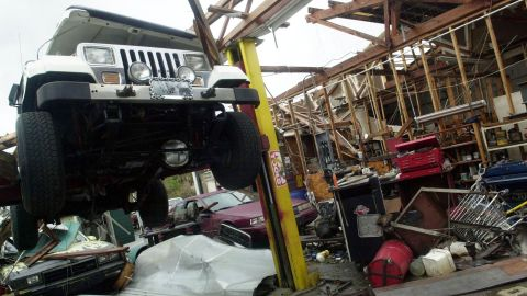 Just three weeks after Frances, on September 26, 2004, Hurricane Jeanne's 60-mile-wide eye crossed the Florida coast near Stuart, at virtually the same place Frances made landfall. Maximum winds were estimated at 120 mph. The storm tore apart this auto shop in Sebastian, Florida. Jeanne was blamed for three deaths in Florida, and one each in Puerto Rico, South Carolina and Virginia.