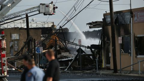 A firefighter sprays water on a hot spot on September 13.