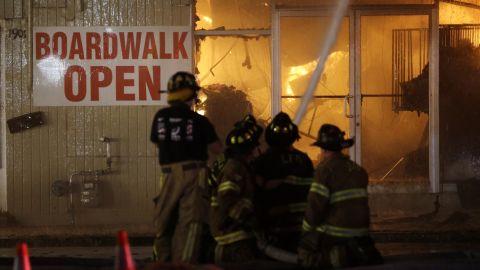 Firefighters battle a blaze in a building on the boardwalk on September 12.