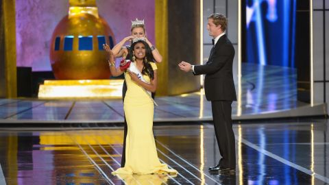Nina Davuluri, representing New York, is crowned 2014 Miss America by 2013 Miss America Mallory Hagan during the Miss America Competition at Boardwalk Hall Arena on September 15, 2013 in Atlantic City, New Jersey.