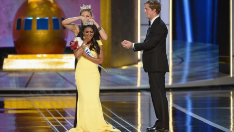 ATLANTIC CITY, NJ - SEPTEMBER 15: Miss America 2014 contestant Miss New York Nina Davuluri (in front) is crowned 2014 Miss America by 2013 Miss America Mallory Hagan during the Miss America Competition at Boardwalk Hall Arena on September 15, 2013 in Atlantic City, New Jersey. (Photo by Michael Loccisano/Getty Images)