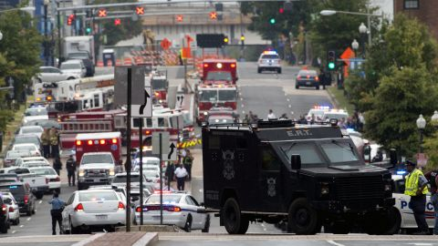 Police block off a road leading to the Washington Navy Yard.