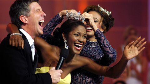 Miss Florida, Ericka Dunlap of Orlando, Florida, center, is crowned Miss America 2004, at Boardwalk Hall in Atlantic City.