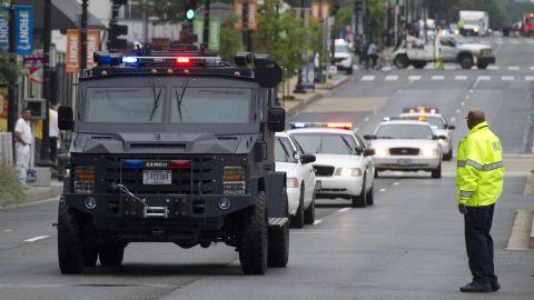 Police vehicles move toward the Navy Yard.