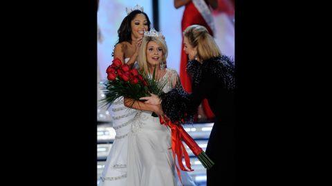 Teresa Scanlan, from Nebraska, is crowned Miss America 2011 as Miss America 1971, Phyllis George, right, gives Scanlan flowers.