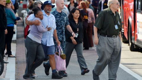 A man walks with a woman after they were reunited at Nationals Park.