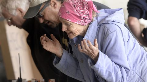 Jerrie McBride checks in with authorities after being rescued by helicopter from the Big Elk Meadows area in Boulder, Colorado, on September 16.