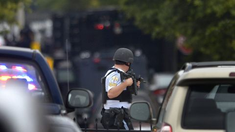 A U.S. Park Police officer stands guard near the scene of the shooting.