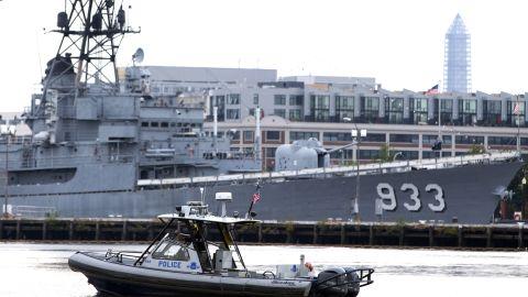 A police boat patrols the waters at the Washington Navy Yard.