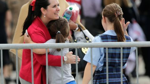 A woman reunites with her child inside Nationals Park.