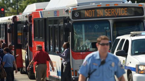 People step off buses at Parking Lot B of Nationals Park, which was set up as a gathering point for family members of Navy Yard employees in the wake of the shooting.