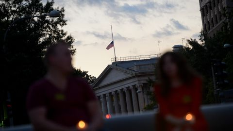 The U.S. flag above the Treasury Department flies at half-staff on September 16.